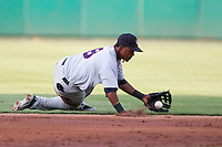 Jean Segura (8) of the Arkansas Travelers slides to stop a ground ball during a game against the Springfield Cardinals at Hammons Field on June 13, 2012 in Springfield, Missouri. (David Welker/Four Seam Images).