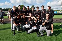 Batavia Muckdogs Joey Steele, Bryan Hoeing, Andrew Nardi, Easton Lucas, Brock Love, Jackson Rose, Juan Frias (standing);  Geremy Galindez, Jonaiker Villalobos, Joey Steele, Edgar Martinez, Edison Suriel, Josh Simpson (kneeling), celebrate after clinching the Pinckney Division Title during a NY-Penn League game against the Auburn Doubledays on September 2, 2019 at Falcon Park in Auburn, New York.  Batavia defeated Auburn 7-0 to clinch the Pinckney Division Title.  (Mike Janes/Four Seam Images)