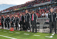 05 May 2012: Toronto FC coach Aron Winter with his training staff stand during the national anthems in an MLS game between DC United and Toronto FC at BMO Field in Toronto..D.C. United won 2-0.