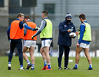 17th October 2020; TEG Cusack Park, Mullingar, Westmeath, Ireland; Allianz Football Division 2 Gaelic Football, Westmeath versus Laois; A Laois GAA official hands out face masks to substitutes as they leave the field after the warm up