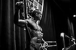 Bodybuilder flexes muscles for judges on stage during the 2014 IFBB International Bodybuilding & FITNESS Invitation Championship on 23 July 2014 at the Kowloon Exhibition Center in Hong Kong, China. Photo by Xaume Olleros / Power Sport Images