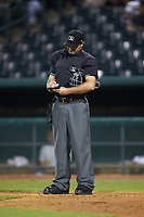 Home plate umpire Thomas Fornarola updates his lineup card during the South Atlantic League game between the West Virginia Power and the Greensboro Grasshoppers at First National Bank Field on August 9, 2018 in Greensboro, North Carolina. The Power defeated the Grasshoppers 9-7 in game two of a double-header. (Brian Westerholt/Four Seam Images)