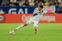 CARSON, CA - SEPTEMBER 15: Jonathan dos Santos #8 of the Los Angeles Galaxy gets after a loose ball during a game between Sporting Kansas City and Los Angeles Galaxy at Dignity Health Sports Park on September 15, 2019 in Carson, California.