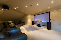 BNPS.co.uk (01202) 558833. <br /> Pic: TailorMade/AshleyFaull/BNPS<br /> <br /> Pictured: The cinema in the £6m mansion which has now been demolished. <br /> <br /> A wealthy homeowner has made the 'brave' decision to demolish his £6m seaside mansion that has its own indoor pool, gym and cinema. <br /> <br /> Ashley Faull has flattened the 20-year-old luxury house to build nine new flats to meet the increasing demand for housing that has led to a surge in property prices.<br /> <br /> The apartments will be priced between £1.495m to £2.8m.<br /> <br /> The now ruined four-storey and 19-room home sits on a half-an-acre plot that backs on to Poole Harbour and overlooks exclusive Sandbanks in Dorset.