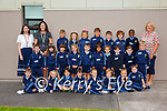 Teachers Elaine Kavanagh (back left) and Catherine Doyle with Eileen O'Mahony SNA (back right) and the Junior Infants of St  Olivers NS Killarney on Wednesday (school doesn't have permission to print kids names)
