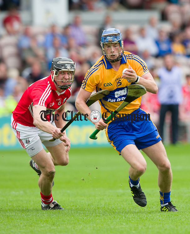 Bobby Duggan of Clare in action against Tadhg Healy of Cork during their Intermediate hurling game at Thurles. Photograph by John Kelly.