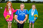 Three members of the Tralee Harriers Athletics Club , who each won double gold at the recent athletics competition in Tullamore. L to r: Aria Collins (Double Gold U9 60m long jump), Patsy O'Connor (Double Gold, over 65 discus and javelin) and Sadie Lynch (Double Gold, 60m long jump).
