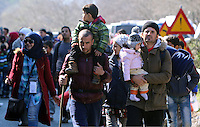 Pictured: Migrants walk on the motorway Thursday 25 February 2016<br /> Re: Hundreds of migrants, including families with young children, that were stranded at Tempe in central Greece, were forced to walk on foot on the motorway to reach Idomen, about 168 kilometres away, in the northern part of the country, at the Greek FYRO Macedonian border. Local police were at first escorting them, then made sure that they were safely transported on coaches.