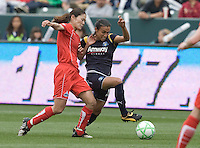 LA Sol's Marta, right, battles for the ball with Washington Freedom's Homare Sawa during the WPS season opening game at the Home Depot Center, Sunday, March 29, 2009. The LA Sol won 2-0.
