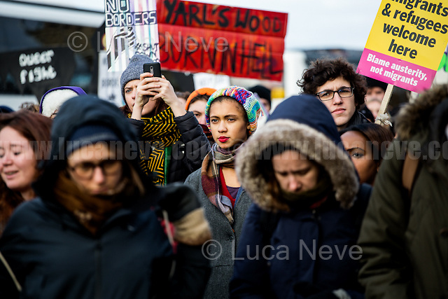 """Bedford (Bedfordshire, England), 03/12/2016. Today, more than two thousand activists and members of the public from across the UK gathered outside the notorious Yarl's Wood I.R.C. Immigration Removal Centre in Bedfordshire, lead by the """"Movement for Justice By Any Means Necessary"""" to protest against the alleged inhuman conditions of the detainees (showed in a recent Channel 4 undercover investigation - http://bit.ly/1E6X4pz) and to call for its immediate closure. <<Yarl's Wood Immigration Removal Centre is a detention centre for foreign nationals prior to their deportation from the United Kingdom, one of 13 such centres currently in the UK. It is located near Milton Ernest in Bedfordshire, England, and is operated by Serco (British outsourcing company based in Hook, Hampshire. It operates public and private transport and traffic control, aviation, military weapons, detention centres, prisons and schools on behalf of its customers - Source Wikipedia.org), who describes the place as """"a fully contained residential centre housing adult women and adult family groups awaiting immigration clearance."""" Its population is, and has been, overwhelmingly female. […] >> (Source - Wikipedia.org at http://bit.ly/1GiTFWB). The protest of today was the 10th demo organised at Yarl's Wood I.R.C. and the largest ever at a detention centre in the UK.<br /> <br /> For more information please click here: https://www.facebook.com/events/1774538206143537/ & http://www.movementforjustice.org/"""