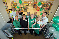 People manager Stephanie Edward (2nd L) with longest serving member of staff Helen Chaffey (C) cutting the ribbon, surrounded by members of staff
