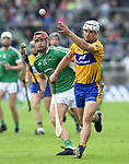 Patrick O'Connor of Clare in action against Barry Nash of Limerick during their Munster Championship semi-final at Thurles.  Photograph by John Kelly.