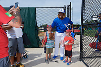 Dunedin Blue Jays Vladimir Guerrero Jr. (27) poses for a photo with two young fans after a Florida State League game against the Clearwater Threshers on April 7, 2019 at Jack Russell Memorial Stadium in Clearwater, Florida.  Dunedin defeated Clearwater 2-1.  (Mike Janes/Four Seam Images)