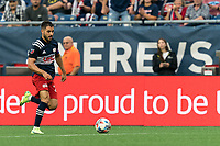 FOXBOROUGH, MA - JULY 25: Carles Gil #22 of New England Revolution dribbles down the wing during a game between CF Montreal and New England Revolution at Gillette Stadium on July 25, 2021 in Foxborough, Massachusetts.