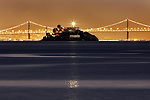 Alcatraz light house reflects a ray of light over the calm seas of the San Francisco Bay.  .