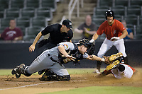Luis Gonzalez (6) of the Kannapolis Intimidators slides head first across home plate ahead of the tag by West Virginia Power catcher Arden Pabst (25) as home plate umpire Jude Koury looks on at Kannapolis Intimidators Stadium on July 19, 2017 in Kannapolis, North Carolina.  The Power defeated the Intimidators 7-4 in 11 innings.  (Brian Westerholt/Four Seam Images)
