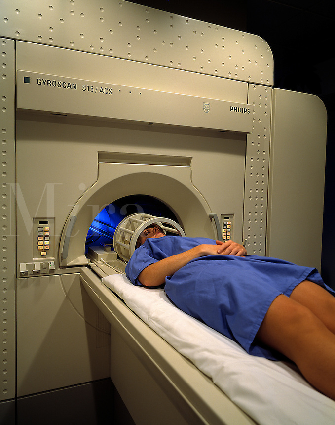 A patient receives a CAT scan.