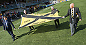 SFL Chief David Longmuir helps Alloa Director Mike Mulraney (top left) and fellow Directors unfurl the Third Division Championship Flag 2011 2012.