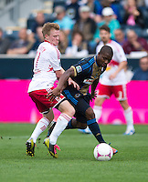 Dax McCarty (11) of the New York Red Bulls fights for the ball with Michael Lahoud (13) of the Philadelphia Union during the game at PPL Park in Chester, PA.  New York defeated Philadelphia, 3-0.