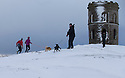 21/02/15  <br /> <br /> After heavy snow showers across the Derbyshire Peak District, dog walkers brave the cold at Solomon's Temple, also known as Grinlow Tower, near Buxton.<br /> <br /> All Rights Reserved - F Stop Press.  www.fstoppress.com. Tel: +44 (0)1335 418629 +44(0)7765 242650