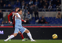 Calcio, Serie A: Lazio vs Milan. Roma, stadio Olimpico, 24 gennaio 2015.<br /> AC Milan's Jeremy Menez, left, kicks to score as Lazio's Lorik Cana tries to stop him during the Italian Serie A football match between Lazio and AC Milan at Rome's Olympic stadium, 24 January 2015.<br /> UPDATE IMAGES PRESS/Isabella Bonotto