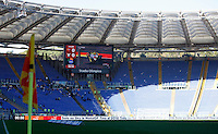 Calcio, Serie A: Roma vs Lazio. Roma, stadio Olimpico, 8 novembre 2015.<br /> Valencia's Motorcycle Grand Prix is broadcasted on scoreboards prior to the start of the Italian Serie A football match between Roma and Lazio at Rome's Olympic stadium, 8 November 2015. Most of the sectors of the stadium were empty due to fan protest against security measurements.<br /> UPDATE IMAGES PRESS/Isabella Bonotto