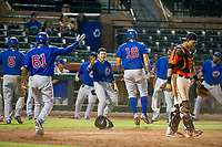 AZL Cubs first baseman Luis Hidalgo (18) celebrates after scoring a run against the AZL Giants on September 5, 2017 at Scottsdale Stadium in Scottsdale, Arizona. AZL Cubs defeated the AZL Giants 10-4 to take a 1-0 lead in the Arizona League Championship Series. (Zachary Lucy/Four Seam Images)