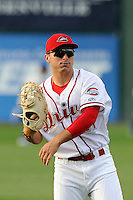 First baseman Nick Longhi (21) of the Greenville Drive warms up before a game against the Lexington Legends on Tuesday, April 14, 2015, at Fluor Field at the West End in Greenville, South Carolina. Longhi is the No. 27 prospect of the Boston Red Sox, according to Baseball America. Lexington won, 5-3. (Tom Priddy/Four Seam Images)
