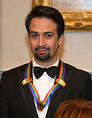 Lin-Manuel Miranda, one of the special honorees for Groundbreaking Work on Hamilton, as he poses with the recipients of the 41st Annual Kennedy Center Honors pose for a group photo following a dinner hosted by United States Deputy Secretary of State John J. Sullivan in their honor at the US Department of State in Washington, D.C. on Saturday, December 1, 2018.  The 2018 honorees are: singer and actress Cher; composer and pianist Philip Glass; Country music entertainer Reba McEntire; and jazz saxophonist and composer Wayne Shorter. This year, the co-creators of Hamilton, writer and actor Lin-Manuel Miranda; director Thomas Kail; choreographer Andy Blankenbuehler; and music director Alex Lacamoire will receive a unique Kennedy Center Honors as trailblazing creators of a transformative work that defies category.<br /> Credit: Ron Sachs / Pool via CNP