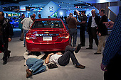 Detroit, Michigan<br /> USA<br /> January 14, 2010<br /> <br /> Industry preview day at the North American International Auto Show at the Cob center in Detroit. <br /> <br /> Automotive professionals representing nearly 1,000 companies, including America's big three; Ford, General Motors and Chrysler, share insights and make connections. A networking opportunity that brings together the latest automotive products and services with the key minds behind them.<br /> <br /> Following a disastrous year that saw GM and Chrysler LLC forced into government-led bankruptcy. U.S. auto sales plunged to 39 percent below a peak in 2005 during the recent ill-founded economic boom. The big, unanswered question here, however, is what the U.S. economy will do following its longest, deepest downturn since the 1930s.<br /> <br /> Chrysler's exhibit on the convention floor was  dramatically scaled back from previous years. Chrysler's appearance, on the other hand, was more of a car wreck, critics said during press previews.