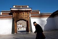 A Tibetan pilgrim at Labrang (Chinese Name - Xiahe) Monastery on the Qinghai-Tibetan Plateau. China.