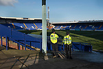 Tranmere Rovers 1 Walsall 3, 05/12/2020. Prenton Park, League Two. Two police officers watching over the pitch inside the ground two hours prior to kick-off before Tranmere Rovers host Walsall in a League Two fixture at Prenton Park, Birkenhead. The game was the first of the season at which spectators were allowed to be present under the Covid-19 restrictions. A crowd of 2000 watched the game which was won by the visitors by 3-1. Photo by Colin McPherson.