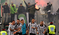 Calcio, Serie A: Roma vs Juventus. Roma, stadio Olimpico, 2 marzo 2015.<br /> Juventus' Carlos Tevez, left, celebrates with teammates, from second left, Leonardo Bonucci, Simone Padoin, Roberto Pereyra and Arturo Vidal after scoring on a free kick during the Italian Serie A football match between AS Roma and Juventus at Rome's Olympic stadium, 2 March 2015.<br /> UPDATE IMAGES PRESS/Riccardo De Luca