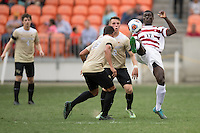 Houston, TX -  Sunday, December 11, 2016: Adrian Alabi (17) of the Stanford Cardinal clears the ball by his goal in the first half against the Wake Forest Demon Deacons at the  NCAA Men's Soccer Finals at BBVA Compass Stadium.