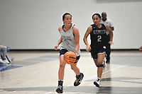 Greenwood's Brooklyn Woolsey (35) drives the ball as Fayetteville's Whitney Brown (2) follows, Thursday, June 10, 2021 during a basketball game at Rogers High School in Rogers. Check out nwaonline.com/210611Daily/ for today's photo gallery. <br /> (NWA Democrat-Gazette/Charlie Kaijo)