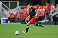 WASHINGTON, DC - JULY 7: Frederic Brilliant #13 of D.C. United moves the ball during a game between Liga Deportiva Alajuense  and D.C. United at Audi Field on July 7, 2021 in Washington, DC.