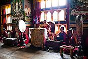 The head lama (centre) leads other Buddhist monks with reading their prayers inside the Ramtanka Temple in Paro, Bhutan. Photo: Sanjit Das/Panos