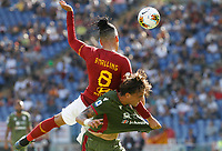 Roma's Chris Smalling, left, heads the ball as he is is challenged by Cagliari's Luca Pellegrini during the Serie A soccer match between Roma and Cagliari at Rome's Olympic Stadium, October 6, 2019. UPDATE IMAGES PRESS/ Riccardo De Luca