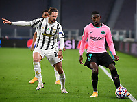 Football Soccer: UEFA Champions League -Group Stage-  Group G - Juventus vs FC Barcellona, Allianz Stadium. Turin, Italy, October 28, 2020.<br /> Barcellona's Osumane Dembele' (r) in action with Juventus' Adrien Rabiot (l) during the Uefa Champions League football soccer match between Juventus and Barcellona at Allianz Stadium in Turin, October 28, 2020.<br /> UPDATE IMAGES PRESS/Isabella Bonotto