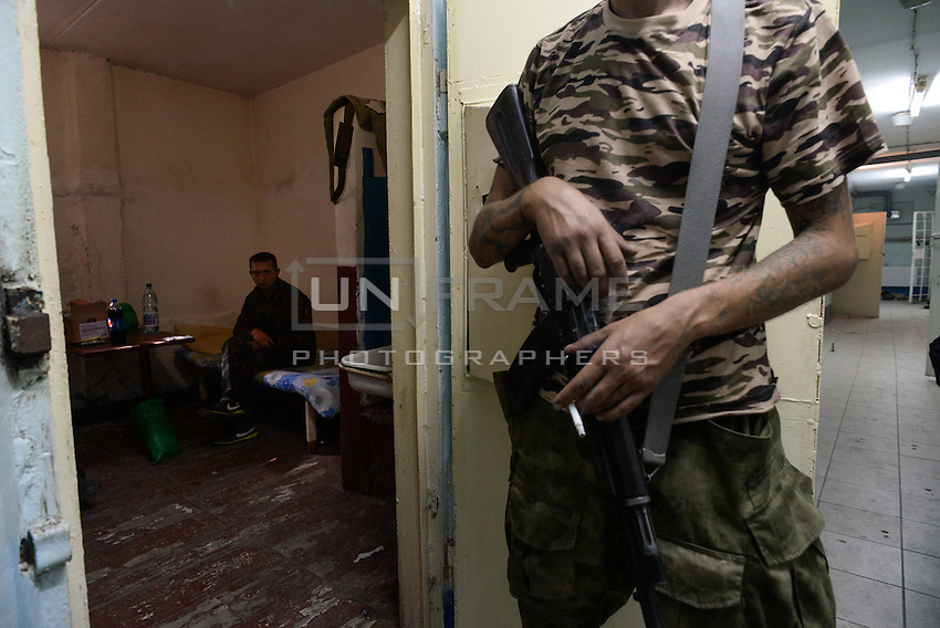 Pro-Russian rebels guards the Ukrainian soldier captured during fighting near Illovaysk. Donetsk, Eastern Ukraine