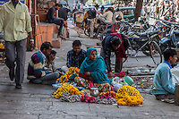 Jaipur, Rajasthan, India.  Flower Vendor outside the Entrance to a Hindu Temple.
