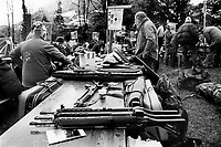 "Switzerland. Canton Uri. Rütli. A group of competitors and members of the riflemen's association  talk together while their automatic or semi-automatic assault rifles SG 550 are laid on the table during the Rütlischiessen. Rütli or Grütli is a mountain meadow overlooking the lake Lucerne where the oath of the Rütlischwur for the forming of the Old Swiss Confederacy is said to have occurred as the legendary turning-point in the pursuit of independence. To commemorate this historic event, the riflemen's association of Lucerne organized the Rütli rifle match (Rütlischiessen) in 1862. It is held every year on the Wednesday before Martinmas (Saint Martin's Day). Thousand competitors from all over Switzerland fire their fifteen shots at targets arranged on a cliff. The SG 550 is an assault rifle manufactured by Swiss Arms AG (formerly Schweizerische Industrie Gesellschaft) of Neuhausen, Switzerland. ""SG"" is an abbreviation for Sturmgewehr, or ""assault rifle"". The rifle is based on the earlier 5.56mm SG 540 and is also known as the Fass 90 or Stgw 90. An assault rifle is a selective-fire rifle that uses an intermediate cartridge and a detachable magazine. 9.11.2016 © 2016 Didier Ruef"