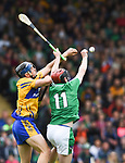 David McInerney of Clare in action against David Dempsey of Limerick  during their Munster Championship semi-final at Thurles.  Photograph by John Kelly.