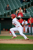 Peoria Chiefs shortstop Tommy Edman (16) follows through on a swing during a game against the West Michigan Whitecaps on May 8, 2017 at Dozer Park in Peoria, Illinois.  West Michigan defeated Peoria 7-2.  (Mike Janes/Four Seam Images)