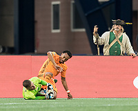 FOXBOROUGH, MA - JUNE 29: Matt Turner #30 fails to control save from Marlon Hairston #14 during a game between Houston Dynamo and New England Revolution at Gillette Stadium on June 29, 2019 in Foxborough, Massachusetts.