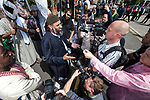 """© Joel Goodman - 07973 332324 . 30/07/2011 . London , UK.  ANJEM CHOUDARY speaking to media . Islamist group, Muslims Against Crusades, march through Waltham Forest in East London, calling for Sharia law to be imposed in the UK. MAC supporters carried """" Shariah Controlled Zone """" stickers, that have been appearing in parts of East London which have caused concern to some residents. Photo credit : Joel Goodman"""