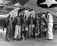 The Photo squadron personal, planes, and cameras equipment.  Chief Dixon musters a group of students in the Photo Squadron, assigns them their targets.  Location: NAS Pensacola, Florida.