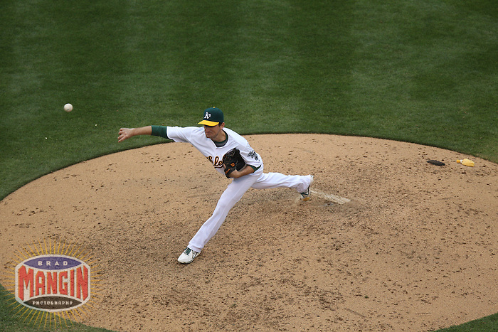 OAKLAND, CA - JUNE 15:  Dan Otero #61 of the Oakland Athletics pitches against the Seattle Mariners during the game at O.co Coliseum on Saturday June 15, 2013 in Oakland, California. Photo by Brad Mangin