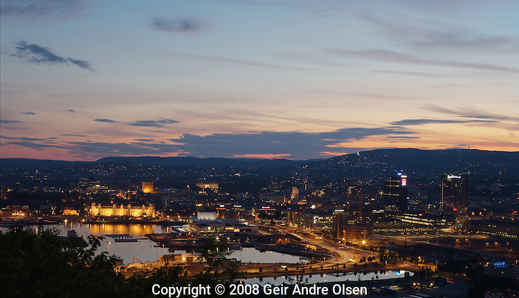 Oslo, capital of Norway, by night, taken from Ekeberg, looking down at the new opera house, Oslo S railroad station and downtown Oslo