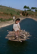 Children wood carriers in India. Child labor as seen around the world between 1979 and 1980 - Photographer Jean Pierre Laffont, touched by the suffering of child workers, chronicled their plight in 12 countries over the course of one year.  Laffont was awarded The World Press Award and Madeline Ross Award among many others for his work.